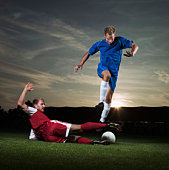 Two Soccer player fighting for ball