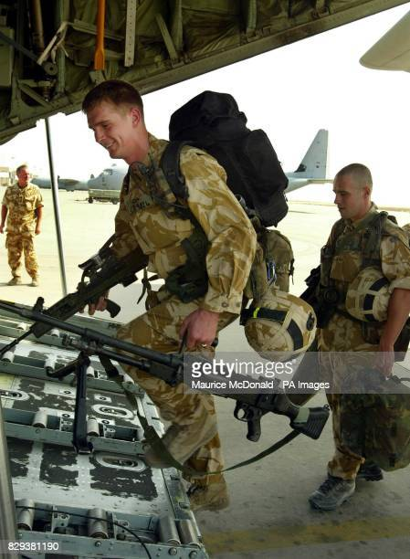 Two soldiers from the Black Watch board a Hercules C130 at Basra International Airport The Black Watch battle group with attachments from 40 Commando...