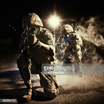 two soldiers in action