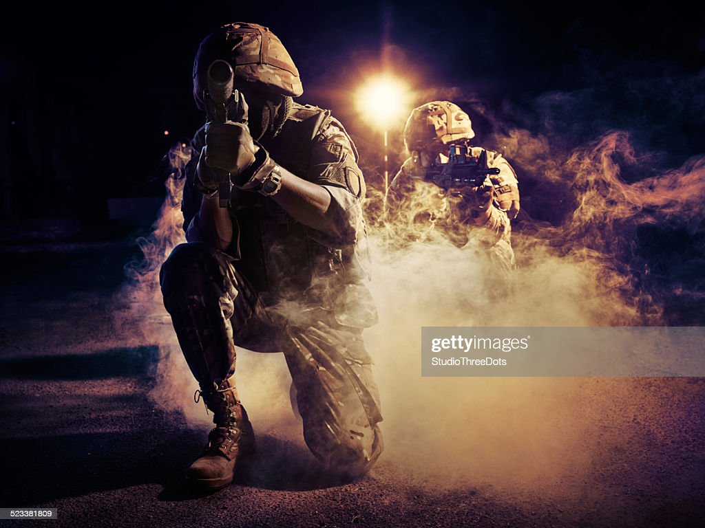 two soldiers in action : Stock Photo