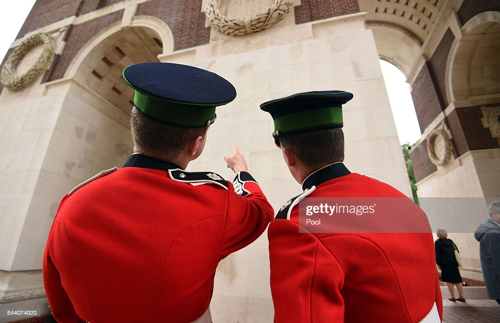 Two soldiers look up at the names inscribed on the pillars of the Thiepval Memorial after during the Commemoration of the Centenary of the Battle of the Somme at the Commonwealth War Graves Commission Thiepval Memorial on July 1, 2016 in Thiepval, France. The event is part of the Commemoration of the Centenary of the Battle of the Somme at the Commonwealth War Graves Commission Thiepval Memorial in Thiepval, France, where 70,000 British and Commonwealth soldiers with no known grave are commemorated.