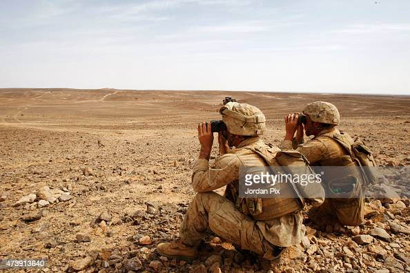 Two soldiers participate in a Jordanian joint military exercise with 18 nations including the US in the 5th annual Eager Lion May 18 2015 in the...