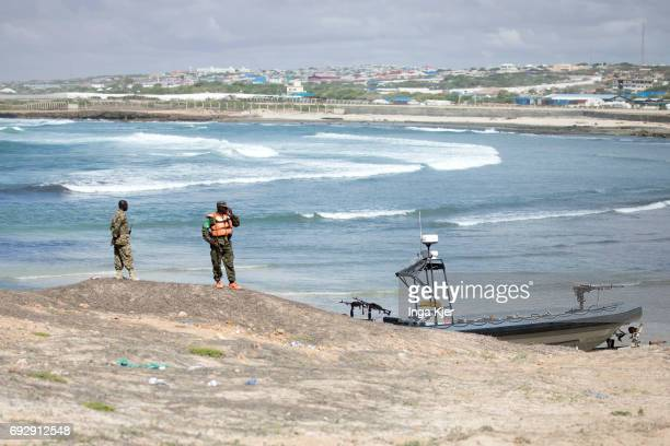Two soldiers patrol the coast off Mogadishu on May 01 2017 in Mogadischu Somalia