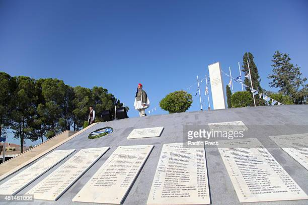 Two soldiers with Cyprus traditional uniforms and Greek traditional uniform are standing on the monument of dead soldiers from the Turkish invasion...