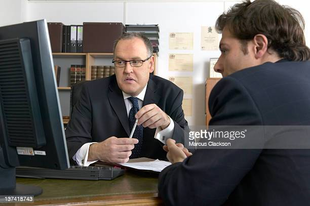 Two solicitors working