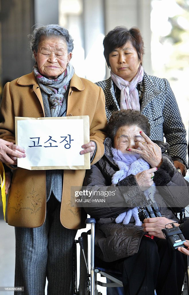 Two South Korean women (L and lower R) forced into sexual slavery by Japan during Tokyo's 1910-45 occupation of the country enter a Seoul prosecutors' office on March 4, 2013, along with a lawyer and other activists to file a defamation suit against a Japanese rock band that called the women 'prostitutes' in a song. A group of South Korean women forced into wartime sexual slavery by Japan filed a defamation suit nday against a little known Japanese rock band for calling them prostitutes. A CD containing a song with the allegedly defamatory lyrics by the band 'Scramble' was mailed -- along with a translated text -- to a shelter caring for so-called 'comfort women' in Gwangju, south of Seoul, last week. AFP PHOTO / KIM JAE-HWAN