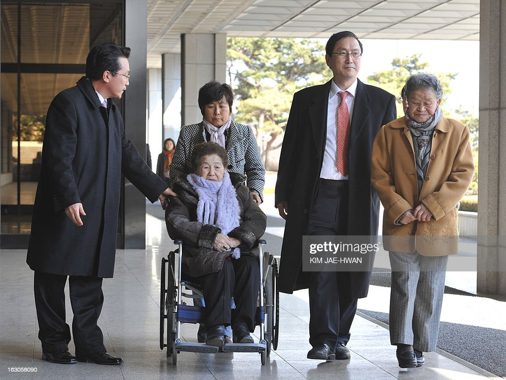 Two South Korean women (R and C) forced into sexual slavery by Japan during Tokyo's 1910-45 occupation of the country enter a Seoul prosecutors' office on March 4, 2013, along with a lawyer and other activists to file a defamation suit against a Japanese rock band that called the women 'prostitutes' in a song. A group of South Korean women forced into wartime sexual slavery by Japan filed a defamation suit nday against a little known Japanese rock band for calling them prostitutes. A CD containing a song with the allegedly defamatory lyrics by the band 'Scramble' was mailed -- along with a translated text -- to a shelter caring for so-called 'comfort women' in Gwangju, south of Seoul, last week.