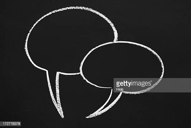 two speech bubbles on a blackboard