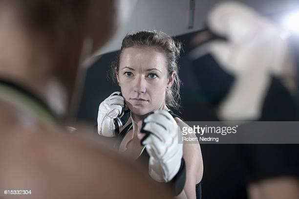 Two sportswomen exercising together boxing, Bavaria, Germany