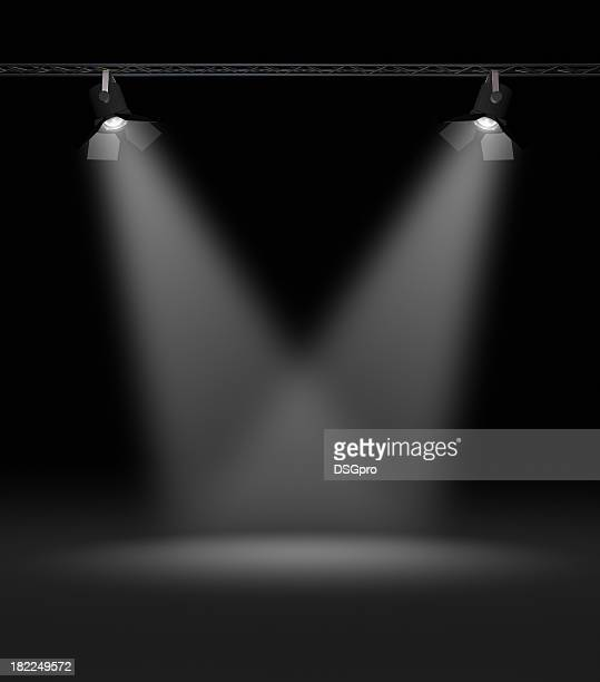 Two spotlights shining on an empty stage