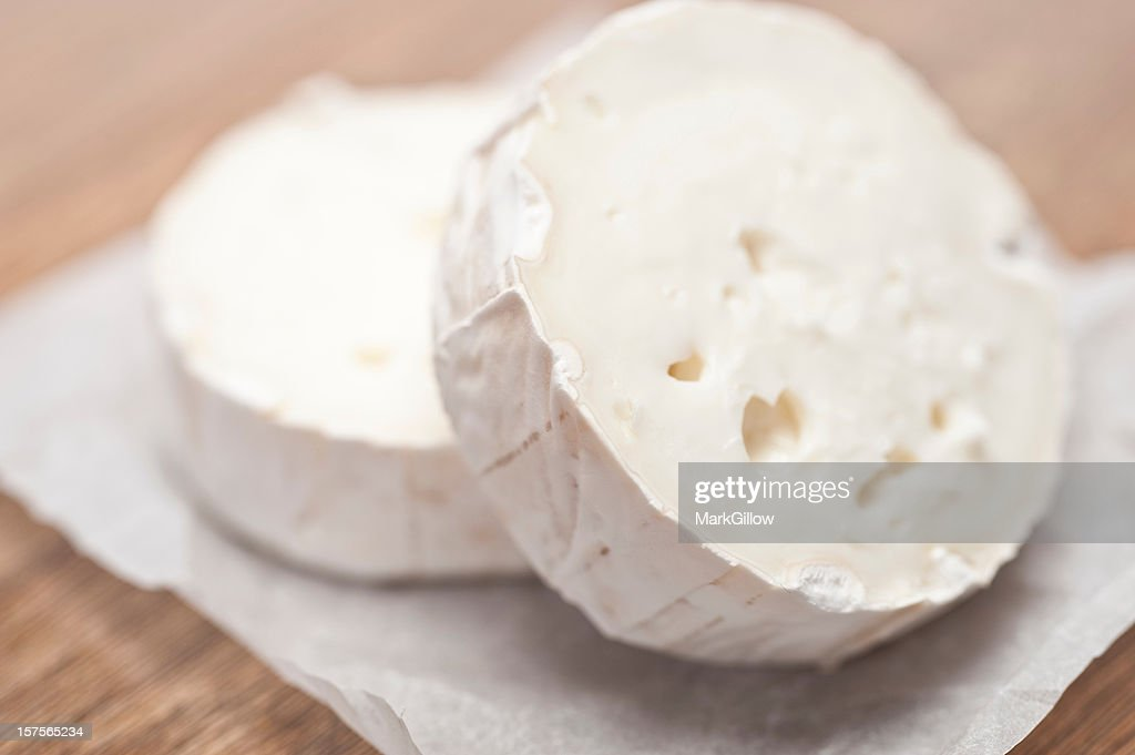 Two stacked and cut pieces of goat cheese