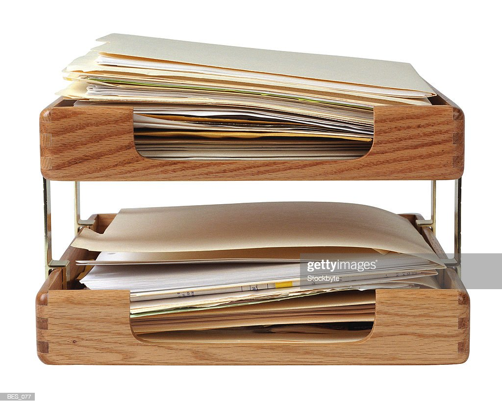 Two stacking trays filled with documents : Stock Photo