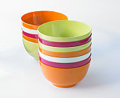 Two stacks of colorful plastic dessert bowls
