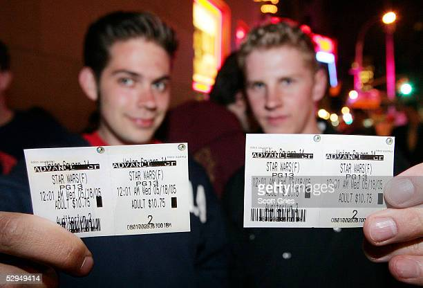 Two Star Wars fans show off their tickets for the midnight premiere of 'Star Wars Episode III Revenge of the Sith' at UA Regal Cinemas May 18 2005 in...