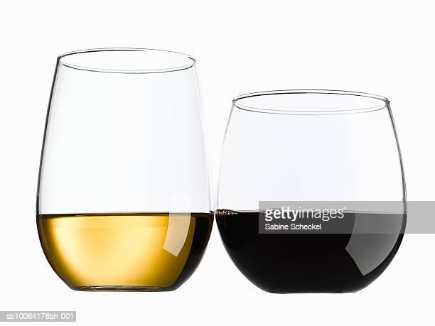 Two stemless glasses with red wine and white wine
