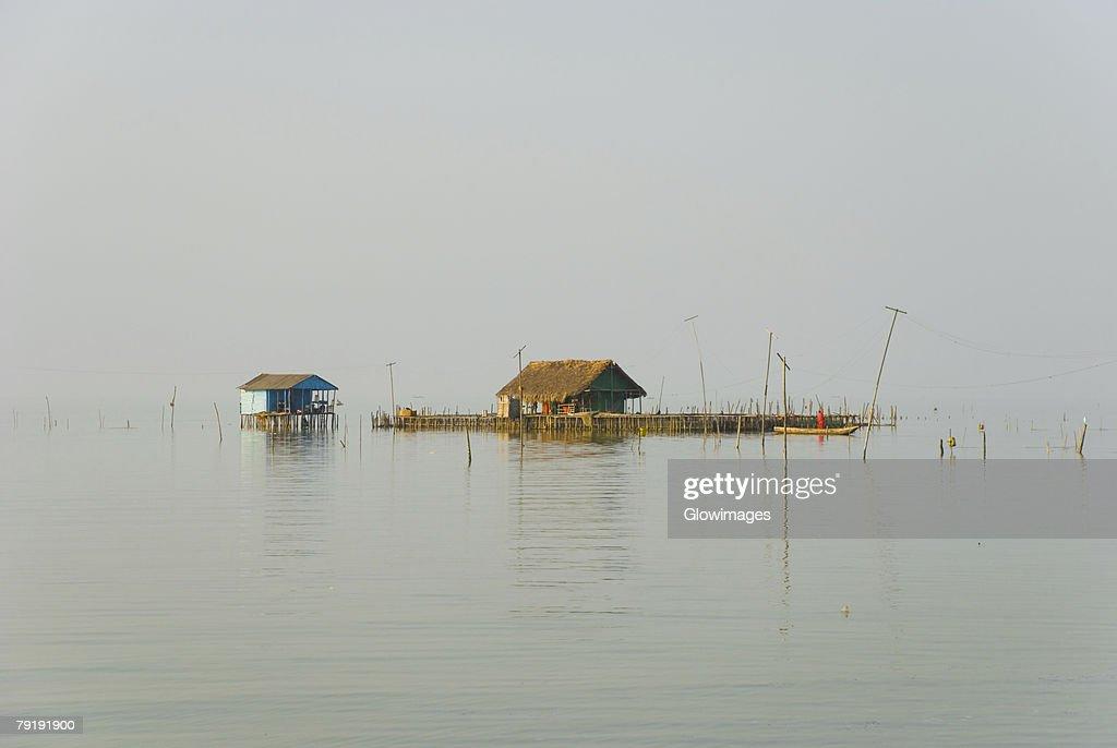 Two stilt houses in the river, Cienaga, Atlantico, Colombia : Stock Photo