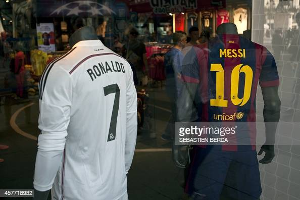 Two store mannequins sport the jerseys of Real Madrid's Portuguese forward Ronaldo Cristiano and Barcelona's Argentinian forward Lionel Messi in a...
