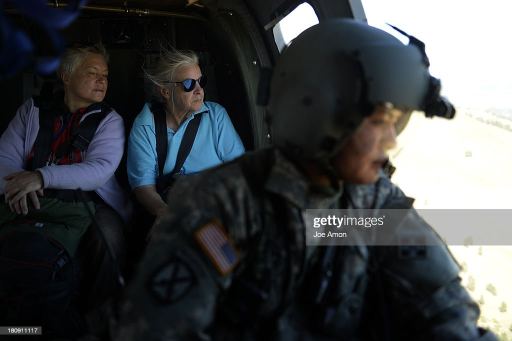 two stranded ladies with S/sgt Jose Pantoja after they were hoisted up to a UH-60 Black Hawk near Jamestown during search and rescue flight with members of the 2-4 GSAB with the 4th ID of Fort Carson September 17, 2013 Boulder, CO.