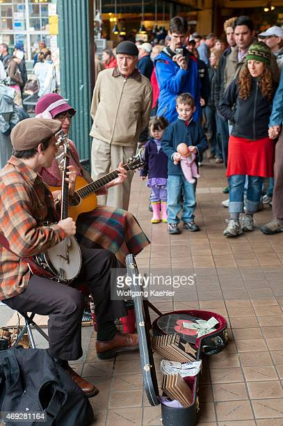 Two street performers playing music at the Pike Place Market in Seattle Washington State USA