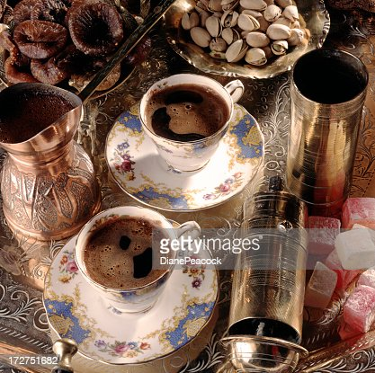 Two strong cups of coffee in fancy cups and saucers