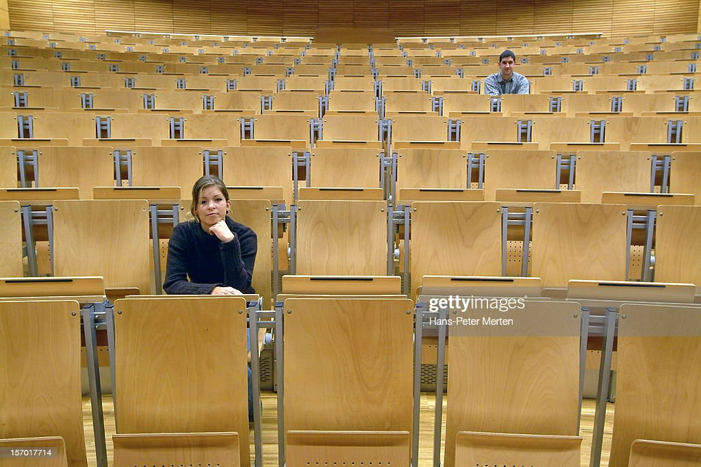 two students at auditorium : Stock Photo
