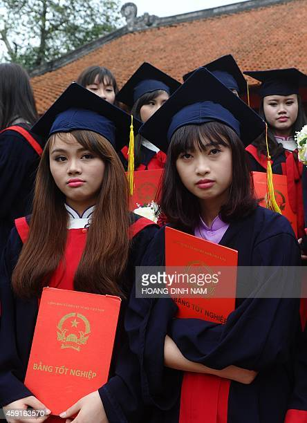 Two students from a local college attend a graduation ceremony at the Temple of Literature in Hanoi on November 18 2014 The temple is where Vietnam's...