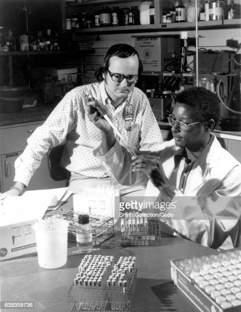 Two students in the University of Tennessee Oak Ridge Graduate School of Biomedical Studies perform an assignment at US Atomic Energy Commission's...