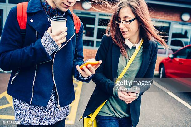 Two students looking at a smart phone