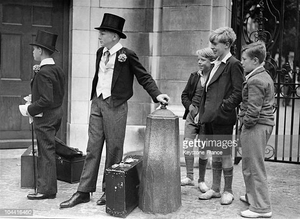 Two students of EATON being observed by admirers while waiting for their parents before the start of the Eaton vs Harrow cricket match at Lord's the...