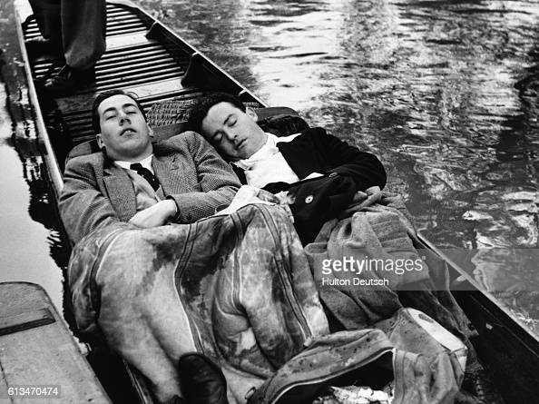 Two students sleep in a boat on the river Cherwell Oxford during the university May Day celebrations