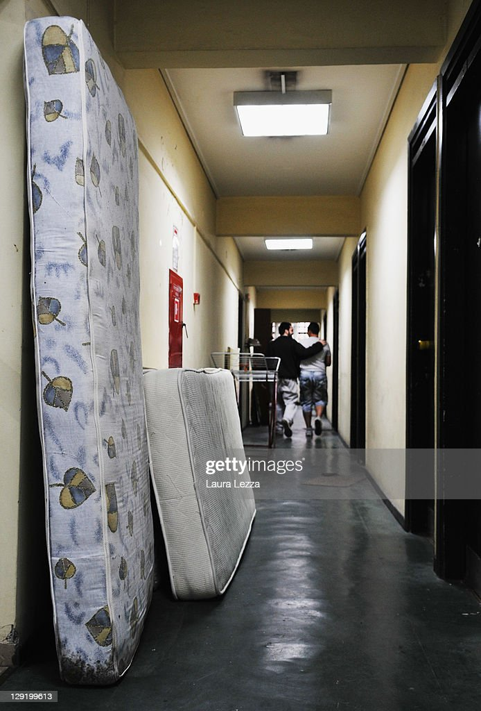 Two students walk in the corridor of the dormitory inside the EIN Insitute on October 13 2011 in Athens Greece The Institute hosts over 265 students...