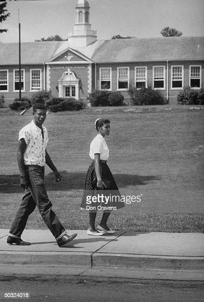 Two students walk past the recently desegregated Clinton High School Clinton Tennessee early September 1956 Pictured are Robert Thacker and JoAnn...
