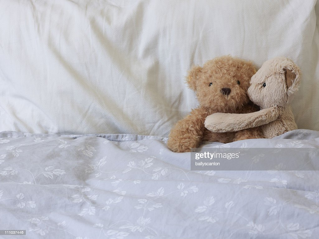 Two Stuffed Teddy Bears, One Embracing The Other. : Stock Photo