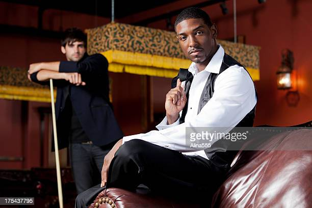 Two stylish man in a night club