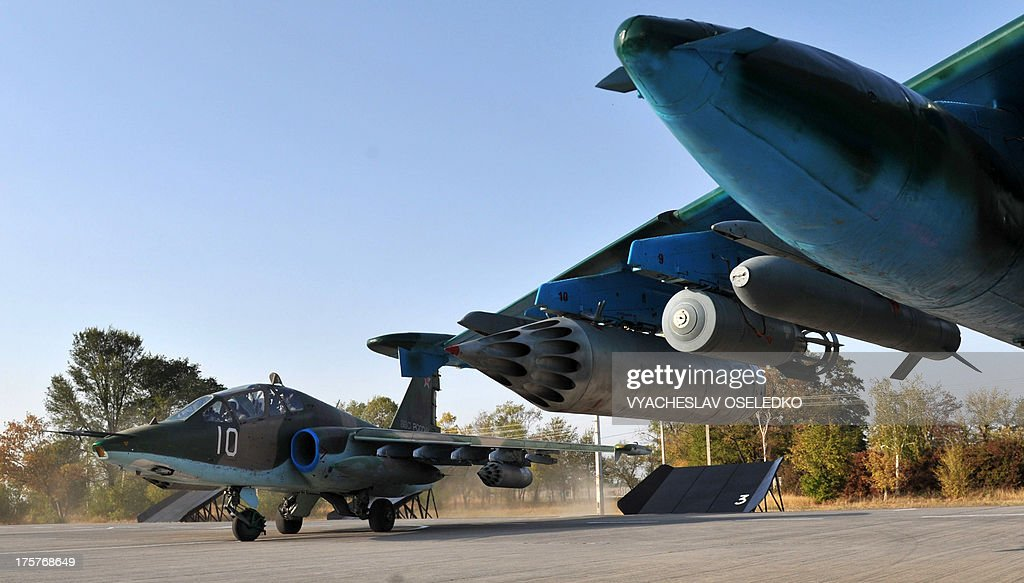 Two SU 25 aircrafts park at the air force base of Collective Security Treaty Organization (CSTO) in Kant some 20km outside Bishkek, on October 8, 2013.
