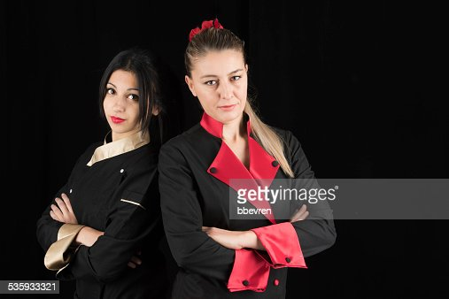 Two successful woman chef posing with confidence : Stock Photo