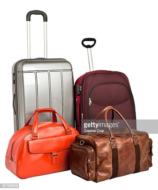 Two suitcases and two leather travel bags