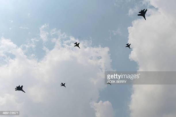 Two Sukhoi fighter jets and four T50i Golden Eagles light fighter aircrafts of the Indonesian Air Force perfom during an airshow in Jakarta on...