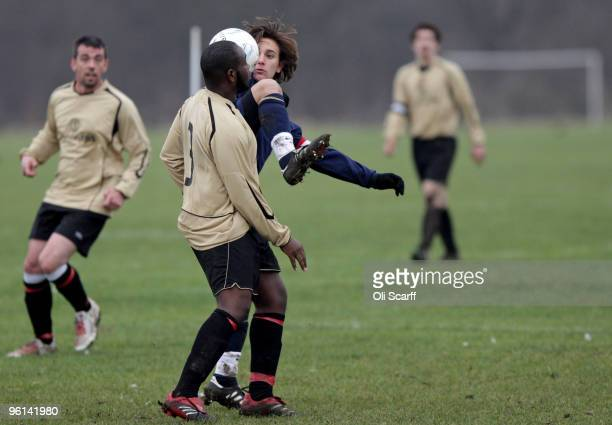 Two Sunday League footballers challenge for the ball during a match on the Hackney Marshes' pitches on January 24 2010 in London England Hackney...