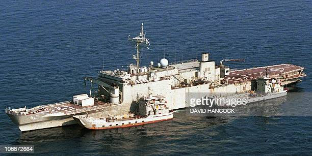 Two supply vessels unload provisions to the Australian troopship HMAS Manoora off the coast of Darwin 09 September 2001 The Australian troopship has...