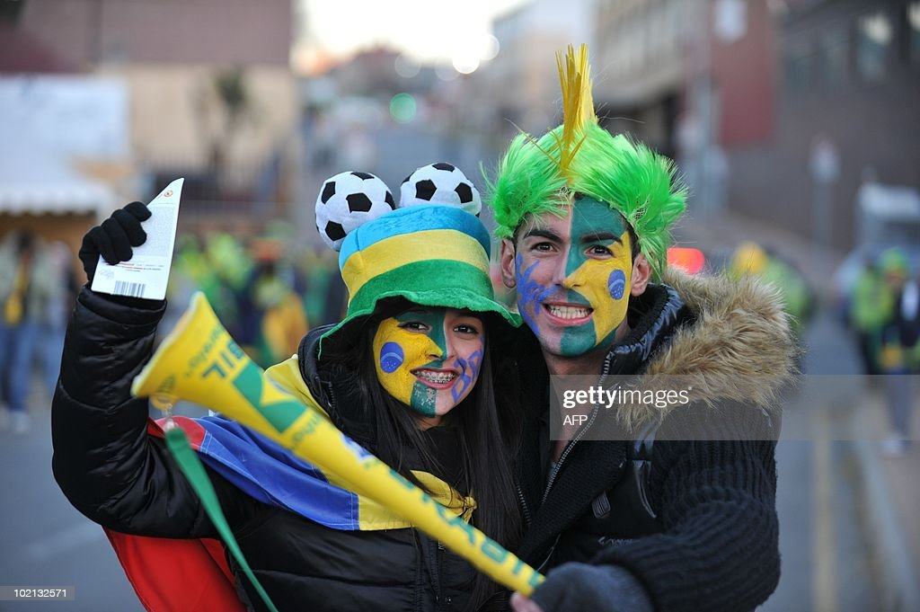 Two supporters of Brazil pose as they arrive at Ellis Park stadium to watch the 2010 Football World Cup match between Brazil and North Korea on June 15, 2010 in Johannesburg.
