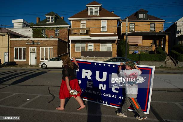 Two supporters of Republican candidate for President Donald J Trump leave after a rally where the candidate some to a crowd of 3000 at Ambridge Area...