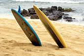 Two surfboards on the beach