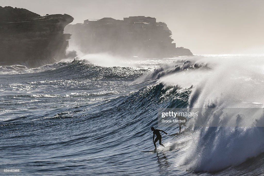 Two surfers share a wave at Bronte beach on May 25, 2016 in Sydney, Australia. All Sydney beaches were closed to swimmers today as large waves pounded the coast.