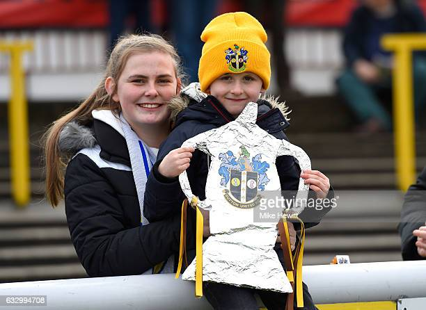 Two Sutton United fans pose for a photo with their homemade FA Cup trophy during The Emirates FA Cup Fourth Round match between Sutton United and...