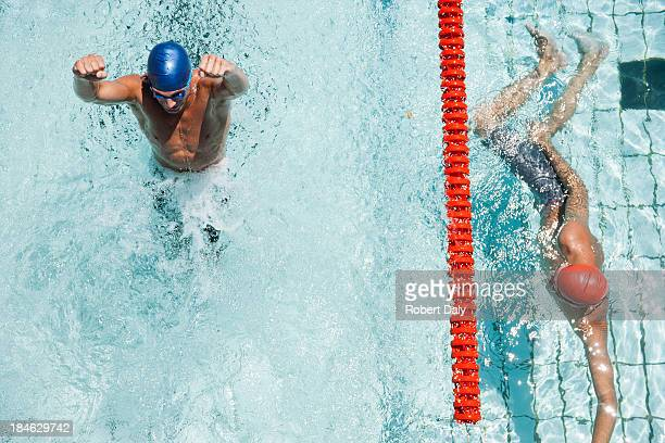 Two swimmers racing with winner excited about victory