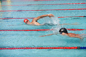 Two swimmers swimming in a pool