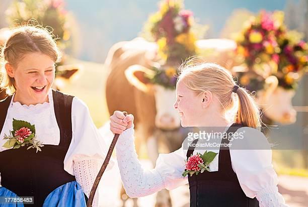 Two Swiss farmer girls having fun during Aelplerfest parade
