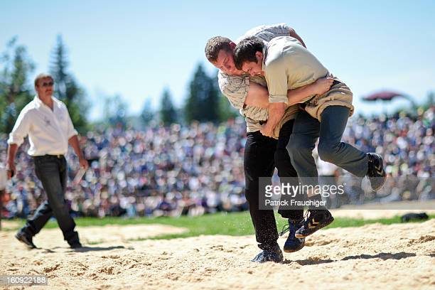 CONTENT] Two Swiss wrestlers fighting at the Emmental Schwing festival in 2011