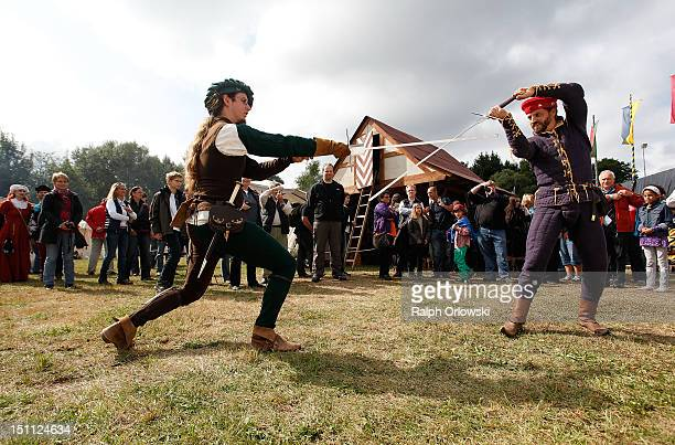 Two swordsmen demonstrate the art of sword fighting during a knights' tournament on September 1 2012 in St Wendel Germany The event marks the 500th...